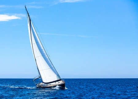 Luxury yachts. Sailing in the wind through the waves at the Aegean Sea.