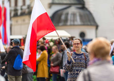 Polonia: Young woman with the Polish flag in the Feast of the Constitution.