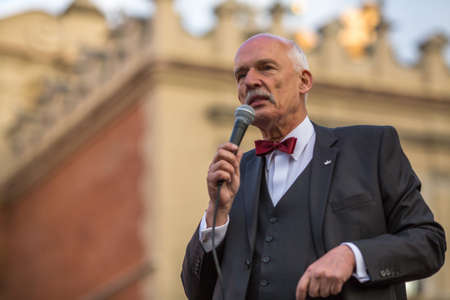 liberal: KRAKOW, POLAND - APR 29, 2015: Janusz Korwin-Mikke or JKM, is a conservative liberal Polish politician, during pre-election rally of presidential candidate of Poland, on main square Krakow.