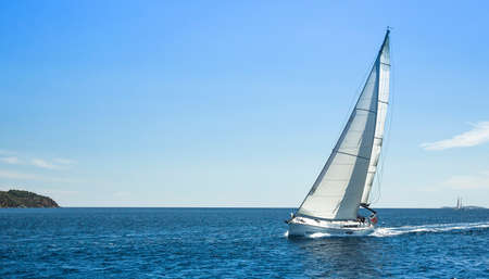 blu sky: Boat competitor of sailing regatta in clear weather. Yachting. Stock Photo