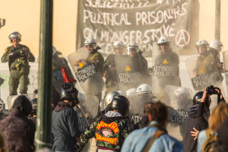 convicted: ATHENS, GREECE - CIRCA APR, 2015: Anarchist protest near Athens University, which has been occupied by protesters - voiced support for a hunger strike by prisoners convicted under anti-terrorism laws. Editorial