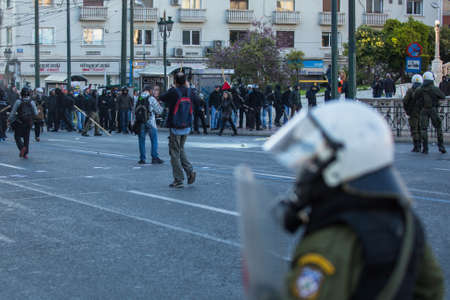 responded: ATHENS, GREECE - CIRCA APR, 2015: Leftist and anarchist groups seeking abolition of new maximum security prisons, clashed with riot police, who responded with tear gas and stun grenades.