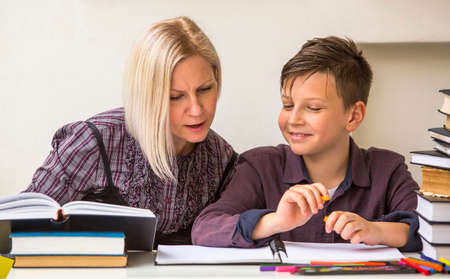 private school: Preschooler engaged lessons with tutor.