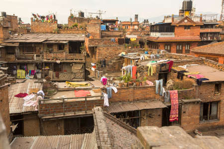 rigid: BHAKTAPUR, NEPAL - CIRCA DEC, 2013: Nepali houses in the city center. The caste system is still intact today but the rules are not as rigid as they were in the past. Editorial