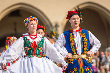 public holiday: KRAKOW, POLAND - MAY 3, 2015: Polish folk collective on Main square during annual Polish national and public holiday the Constitution Day - May 3, 1791 was adopted first Constitution of modern Europe.