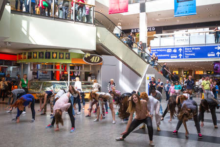 the flash: KRAKOW, POLAND - MAY 16, 2015: Unidentified participants in a dance flash mob at the Central city train station.
