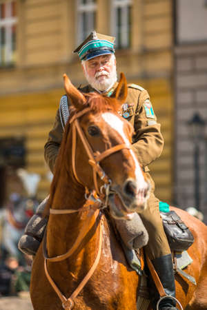 reenacting: KRAKOW, POLAND - MAY 3, 2015: Polish cavalry during annual of Polish national and public holiday the May 3rd Constitution Day. Holiday celebrates declaration of the Constitution of May 3, 1791.