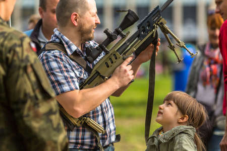 public demonstration: KRAKOW, POLAND - MAY 3, 2015: Unidentified people during demonstration of the military and rescue equipment  in framework Polish national and public holiday the Constitution Day May 3rd. Editorial