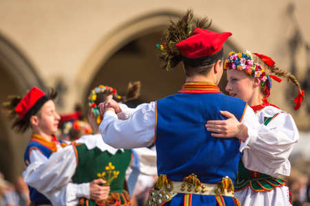 cracow: KRAKOW, POLAND - MAY 3, 2015: Polish folk collective on Main square during annual Polish national and public holiday the Constitution Day - May 3, 1791 was adopted first Constitution of modern Europe.