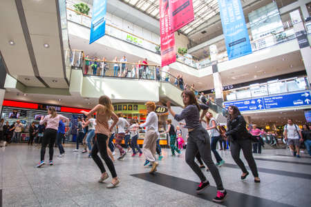 mob: KRAKOW, POLAND - MAY 16, 2015: Unidentified participants in a dance flash mob at the Central city train station.