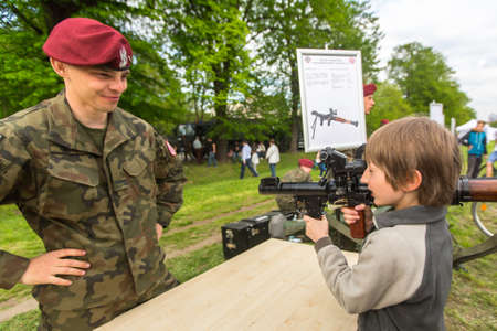 public demonstration: KRAKOW, POLAND - MAY 3, 2015: Unidentified child during demonstration of the military and rescue equipment in framework annual Polish national and public holiday Constitution Day May 3rd. Editorial