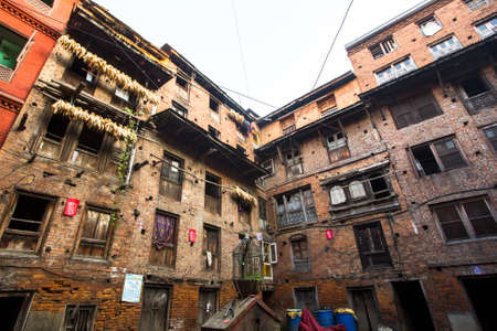 rigid: BHAKTAPUR, NEPAL - CIRCA DEC, 2013: Nepali house in the city center. The caste system is still intact today but the rules are not as rigid as they were in the past. Editorial