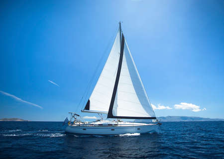 sailing: Sailing Yacht from sail regatta race on blue water Sea. Stock Photo