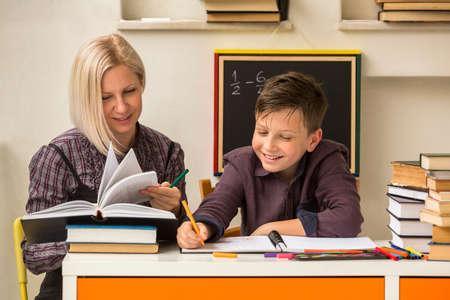 School tutor with young student. Foto de archivo