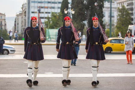 refers: ATHENS, GREECE - CIRCA APR, 2015: Greek soldiers Evzones (or Evzoni) dressed in service uniform, refers to the members of Presidential Guard, an elite ceremonial unit, active from 1833 to present. Editorial
