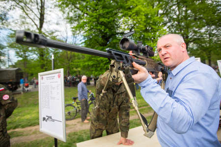 public holiday: KRAKOW, POLAND - MAY 3, 2015: Unidentified people during demonstration of the military and rescue equipment  in framework Polish national and public holiday the Constitution Day May 3rd. Editorial