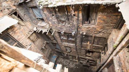 intact: BHAKTAPUR, NEPAL - CIRCA DEC, 2013: Nepali house in the city center. The caste system is still intact today but the rules are not as rigid as they were in the past. Editorial