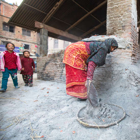 rotates: BHAKTAPUR, NEPAL - CIRCA DEC, 2013: Unidentified Nepalese woman working in the his pottery workshop. More 100 cultural groups have created an image Bhaktapur as Capital of Nepal Arts.