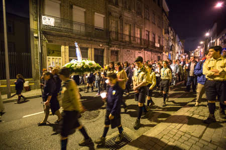 eschatology: PORTO, PORTUGAL - MAY 13, 2015: Procession in honor of Our Lady of Fatima. Events at Fatima gained fame due to elements of secrets, prophecy and eschatology, particularly with regard to World War II.