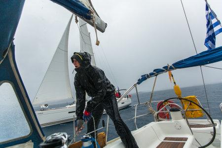 blu sky: PYLOS, GREECE - CIRCA OCT, 2014: Sailors participate in sailing regatta 12th Ellada Autumn 2014 among Greek island group in the Aegean Sea, in Cyclades and Argo-Saronic Gulf.