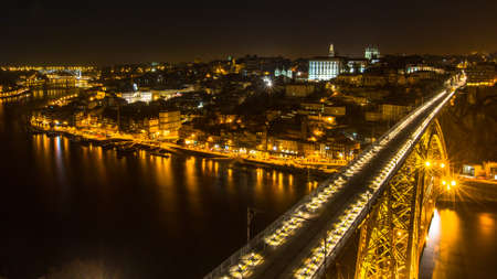 luis: PORTO, PORTUGAL - CIRCA FEB, 2015: Top view famous Dom Luis I Bridge and Douro river at night time in Porto, Portugal. In 1996, UNESCO recognised Old Town of Porto as a World Heritage Site.