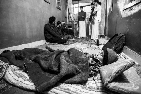 new generation: KATHMANDU, NEPAL - CIRCA DEC, 2013: Unknown child sleeping after lesson at Jagadguru School. School established at 2013, to let new generation learn Sanskrit and preserve Hindu culture. Editorial