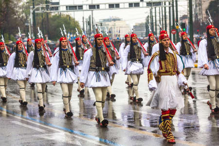 tomb of the unknown soldier: ATHENS, GREECE - MAR 25, 2015: Greek soldiers Evzones dressed in full dress uniform during Independence Day of Greece, on this day, Greeks pay tribute to the heroes of Revolution 1821-1829.