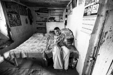 sanskrit: KATHMANDU, NEPAL - CIRCA DEC, 2013: Unknown child after lesson at Jagadguru School. School established at 2013, to let new generation learn Sanskrit and preserve Hindu culture.