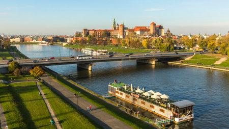 polska monument: KRAKOW, POLAND - CIRCA OCT, 2013: Aerial view of the Vistula River in the historic city center. Vistula is the longest river in Poland, at 1,047 kilometres in length.