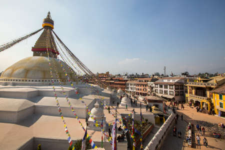 stupa one: KATHMANDU, NEPAL - CIRCA DEC, 2013: Unidentified pilgrims near stupa Boudhanath. Stupa is one of the largest in the world, of 1979 is a UNESCO World Heritage Site.