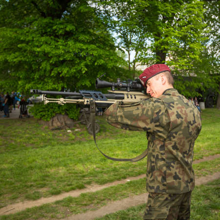 public holiday: KRAKOW, POLAND - MAY 3, 2015: Polish soldier during demonstration of the military and rescue equipment in the framework annual Polish national and public holiday the Constitution Day May 3rd.
