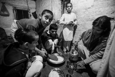 sanskrit: KATHMANDU, NEPAL - CIRCA DEC, 2013: Unknown children during dinner at Jagadguru School. School established at 2013, to let new generation learn Sanskrit and preserve Hindu culture.