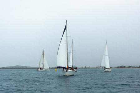 ellada: PYLOS, GREECE - CIRCA OCT, 2014: Sailboats participate in sailing regatta 12th Ellada Autumn 2014 among Greek island group in the Aegean Sea, in Cyclades and Argo-Saronic Gulf. Editorial