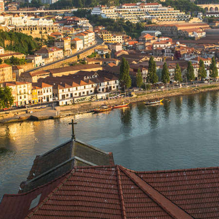 recognised: PORTO, PORTUGAL - JUNE 9, 2015: Douro river, top view of the side of Vila Nova de Gaia. UNESCO recognised Old Town of Porto as a World Heritage Site in 1996.