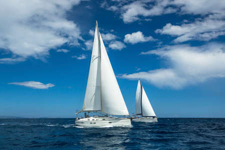 boat crew: Sailing at the Aegean Sea in Greece. Sailing regatta. Luxury yachts.