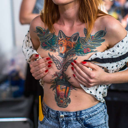 KRAKOW, POLAND - JUNE 6, 2015: Unidentified participant at 10-th International Tattoo Convention in Congress-EXPO Center. This year anniversary TattooFest - tattoo Studio is with an area of 2000m2