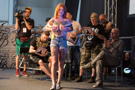 tattoo arm: KRAKOW, POLAND - JUNE 6, 2015: Unidentified participants at 10-th International Tattoo Convention in Congress-EXPO Center. This year anniversary TattooFest - tattoo Studio is with an area of 2000m2 Editorial
