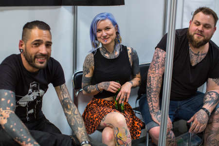 KRAKOW, POLAND - JUNE 6, 2015: Unidentified participants at 10-th International Tattoo Convention in Congress-EXPO Center. This year anniversary TattooFest - tattoo Studio is with an area of 2000m2 Editorial