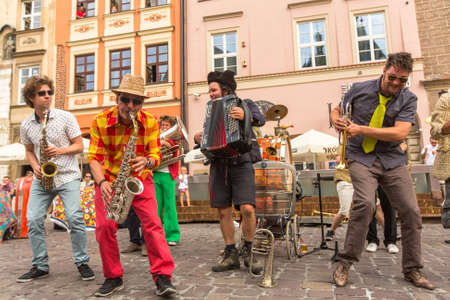 theatre costumes: KRAKOW, POLAND - JUL 12, 2015: Participants at the annually (July 9-12) 28th International Festival of Street Theatres - Orchestre International du Vetex (BelgiumFrance) in the Main Square of Krakow.