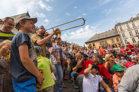 aurillac: KRAKOW, POLAND - JUL 12, 2015: Participants at the annually (July 9-12) 28th International Festival of Street Theatres - Orchestre International du Vetex (BelgiumFrance) in the Main Square of Krakow.