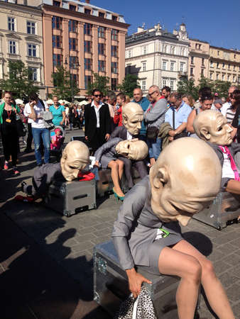 KRAKOW, POLAND - JUL 11, 2015: Unidentified participants at the 28th International Festival of Street Theatres. Annually July 9-12 performances in the Main Square and at random points around the city. Editorial