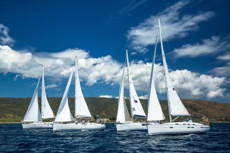 ellada: POROS - ERMIONI, GREECE - CIRCA MAY, 2014: Sailboats participate in sailing regatta 11th Ellada 2014 among Greek island group in the Aegean Sea, in Cyclades and Argo-Saronic Gulf. Editorial