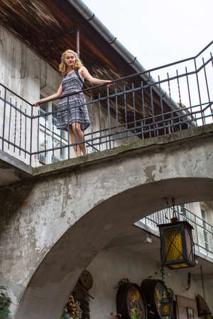 szeroka: Beautiful young girl in the old courtyard of the Jewish quarter of Kazimierz in Krakow.