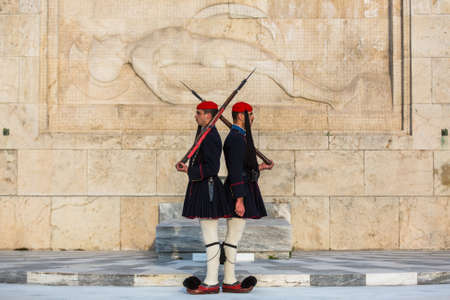 greece: ATHENS, GREECE - CIRCA APR, 2015: Evzone guarding the Tomb of Unknown Soldier in Athens dressed in service uniform, refers to the members of the Presidential Guard, an elite ceremonial unit.