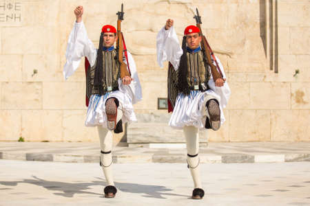 refers: ATHENS, GREECE - CIRCA APR, 2015: Greek soldiers Evzones dressed in full dress uniform, refers to the members of the Presidential Guard, an elite ceremonial unit, active from 1833 to present.