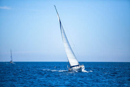 Sailing regatta. Sailing in the wind through the waves at the Aegean Sea in Greece.