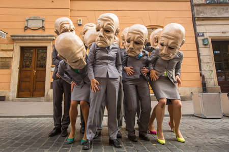 aurillac: KRAKOW, POLAND - JUL 12, 2015: Participants at the annually (Jul 9-12) 28th International Festival of Street Theatres - Teatr KTO (PL) Peregrinus in Main Square and at random points around the city.