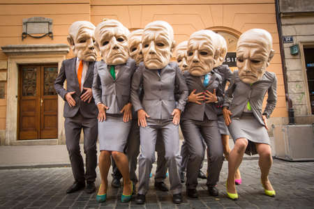theatre masks: KRAKOW, POLAND - JUL 12, 2015: Participants at the annually (Jul 9-12) 28th International Festival of Street Theatres - Teatr KTO (PL) Peregrinus in Main Square and at random points around the city.