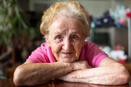 Closeup portrait of happy elderly woman.