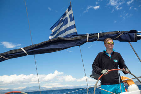 participate: ERMIONI - LEONIDIO, GREECE - CIRCA MAY, 2014: Sailors participate in sailing regatta 11th Ellada Spring 2014 among Greek island group in the Aegean Sea, in Cyclades and Argo-Saronic Gulf. Editorial